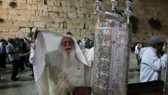 A very old cute rabbi dances with Bible Torah scroll inaugurated in Western Wall Stock Footage