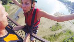 Girl all his face shows the instructor as she scared to jump Stock Footage