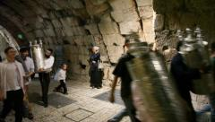 Revelers carry 65 Bible Torah scrolls inaugurated in Western Wall - stock footage