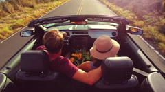 Romantic Convertible Drive into Sunset Stock Footage