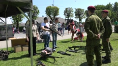 People in demonstration of military guns and rescue equipment. 4K Stock Footage
