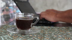 Man working and drinking a cup of americano coffee at coffee bar Stock Footage