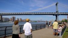 NYC skyline Manhattan Bridge New York City waterfront East River people relax - stock footage
