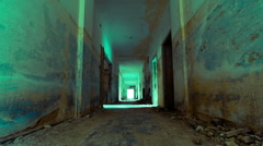 HD linear tracking inside a scary abandoned coridor of an evacuated building - stock footage
