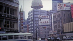 1972: Urban downtown scenes of business men walking past technology billboards. Stock Footage