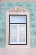 Old window of traditional fisherman houses of Lisbon, Portugal Stock Photos