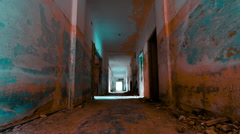 HD linear tracking inside a scary abandoned coridor of an evacuated building Stock Footage