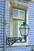 Old window of traditional fisherman houses of Lisbon, Portugal - stock photo