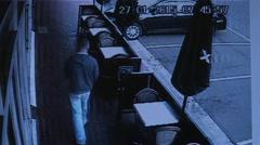 Car slams into shop caught on CCTV Stock Footage