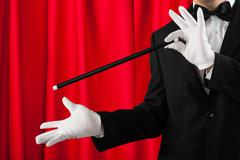 Close-up Of Magician In Suit Showing Trick With Magic Wand Kuvituskuvat