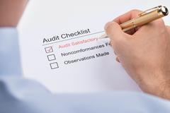 Close-up Of Businessperson Filling Audit Checklist Form Paper Stock Photos