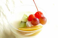 vanilla pudding mousse topping with fruit - stock photo