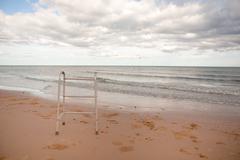 Walker on sand beach Stock Photos