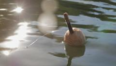 Wooden fishing float on the water Stock Footage