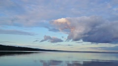Panorama of calm harbour of lake in evening Stock Footage