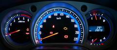 Modern car illuminated dashboard closeup - stock photo