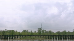 Bayou swamps, New Orleans, driving past water, train goes through, van dolly Stock Footage