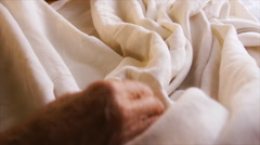 Old woman works with cloth. Stock Footage