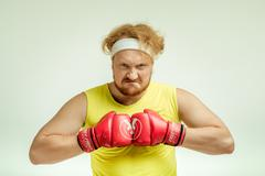 Concept for plump funny sporty man Stock Photos