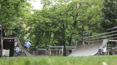 Skate board kids teenage in park Stock Footage
