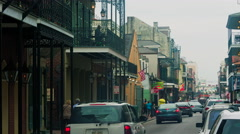 Stock Video Footage of Cars driving down street, people walking, French Quarter, New Orleans, LA