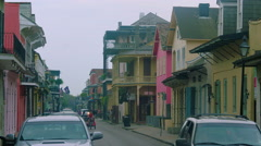 Car & bike taxi, driving on street toward camera, French Quarter, New Orleans, Stock Footage