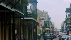 Cars driving down street, people walking, French Quarter, New Orleans, LA Stock Footage