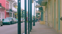 Sidewalk and road, people and cars, French Quarter, New Orleans, LA, Stock Footage