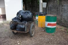 Pile of black bags garbage prepare waste disposal Stock Photos