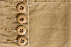 design botton of brown shirt on fabric textile background - stock photo