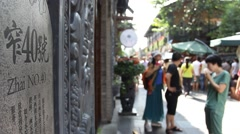 Tourists visit the famous Kuan and Zhai Alley, focused on the road address Stock Footage