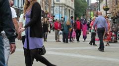 People move along Briggate, Leeds - stock footage