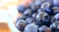 A fresh picked basket of wild blueberry dolly shot Stock Footage