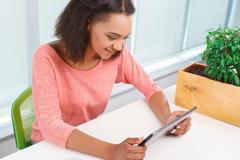 Young mulatto girl using tablet - stock photo