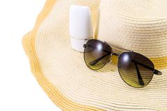 Sunglasses and sunscreen on Hat Stock Photos