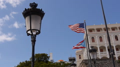 Old classical street ligh pole with USA and Puerto Rico flags in the background. Stock Footage