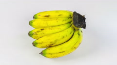 Bunch of bananas isolated and rotation on a white background Stock Footage