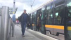 Crowd Exiting A Tram Stock Footage