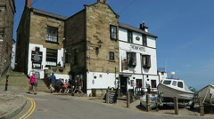 Tourists enjoy visit to Robin Hood Bay village Stock Footage
