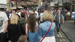 Tourists cross Whitby's swing bridge Stock Footage
