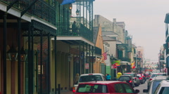 From street view up past flags to balconies, French Quarter, New Orleans, LA Stock Footage