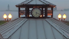 Clock on a pavillion, cam moves down to see water through pav., Baton Rouge, LA, Stock Footage