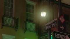 Bourbon Street sign at night in French Quarter, New Orleans, LA, MCU - stock footage