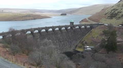 View onto Craig Goch Dam, Elan Valley, Wales from above - stock footage
