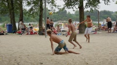 Teanages Are Playing Beach Football at Bolko Lake With a Lot of People Having a Stock Footage