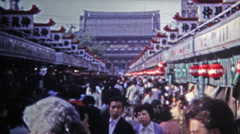 1972: Journey to the popular smoke temple through the crowds. Stock Footage