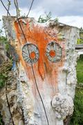 carved owl in a tree trunk - stock photo
