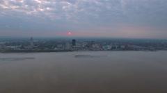 Sunrise over skyline across the river, Baton Rouge, LA, Aerial Stock Footage