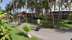 Stock Video Footage of A family rents segway scooters on vacation