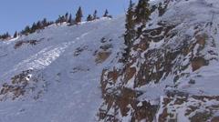 Skier Crashing down cliff Stock Footage